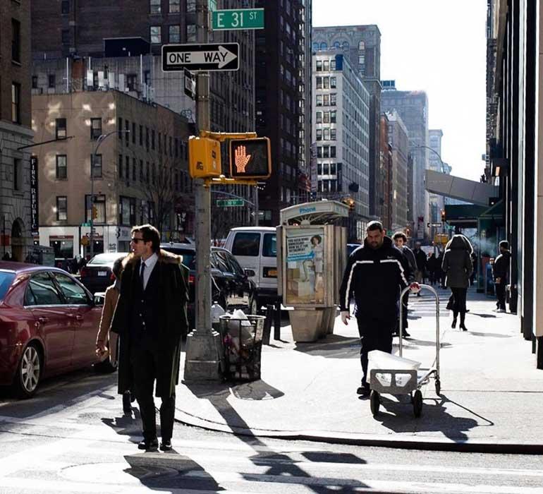 Man walking in New York Street