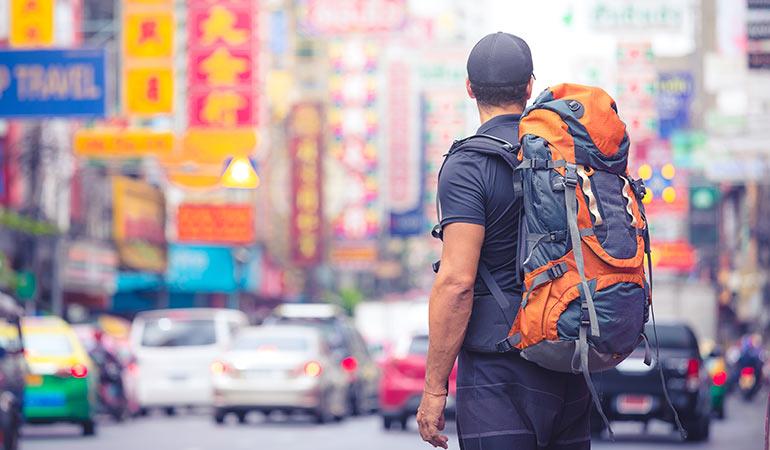 Backpacker in city