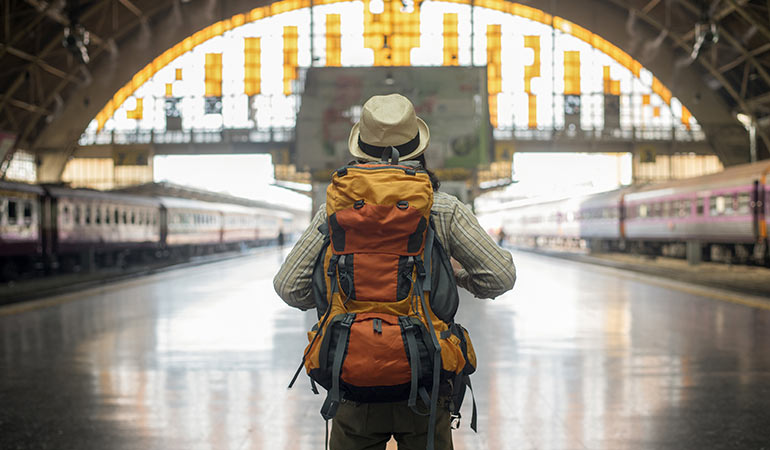 Backpacker at station