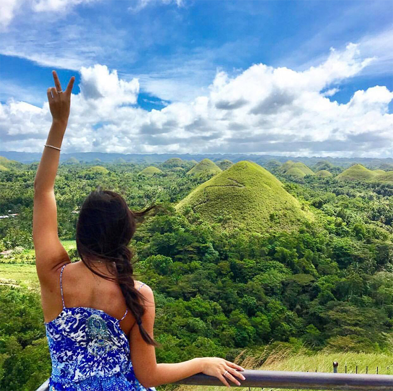 Girl in front of Chocolate Hills Philippines