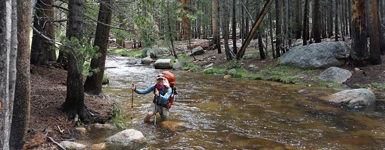 Man hiking through water