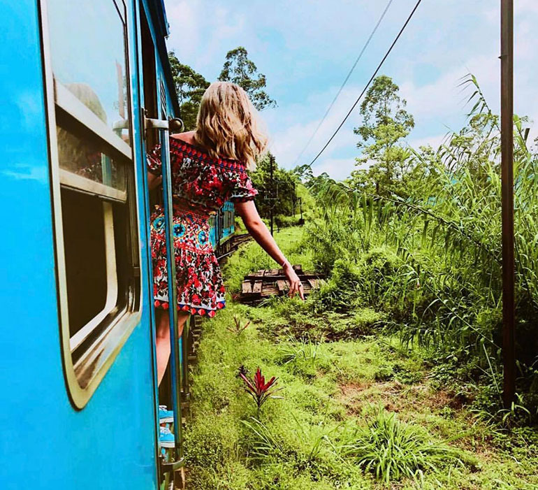 Girl riding Sri Lanka blue train