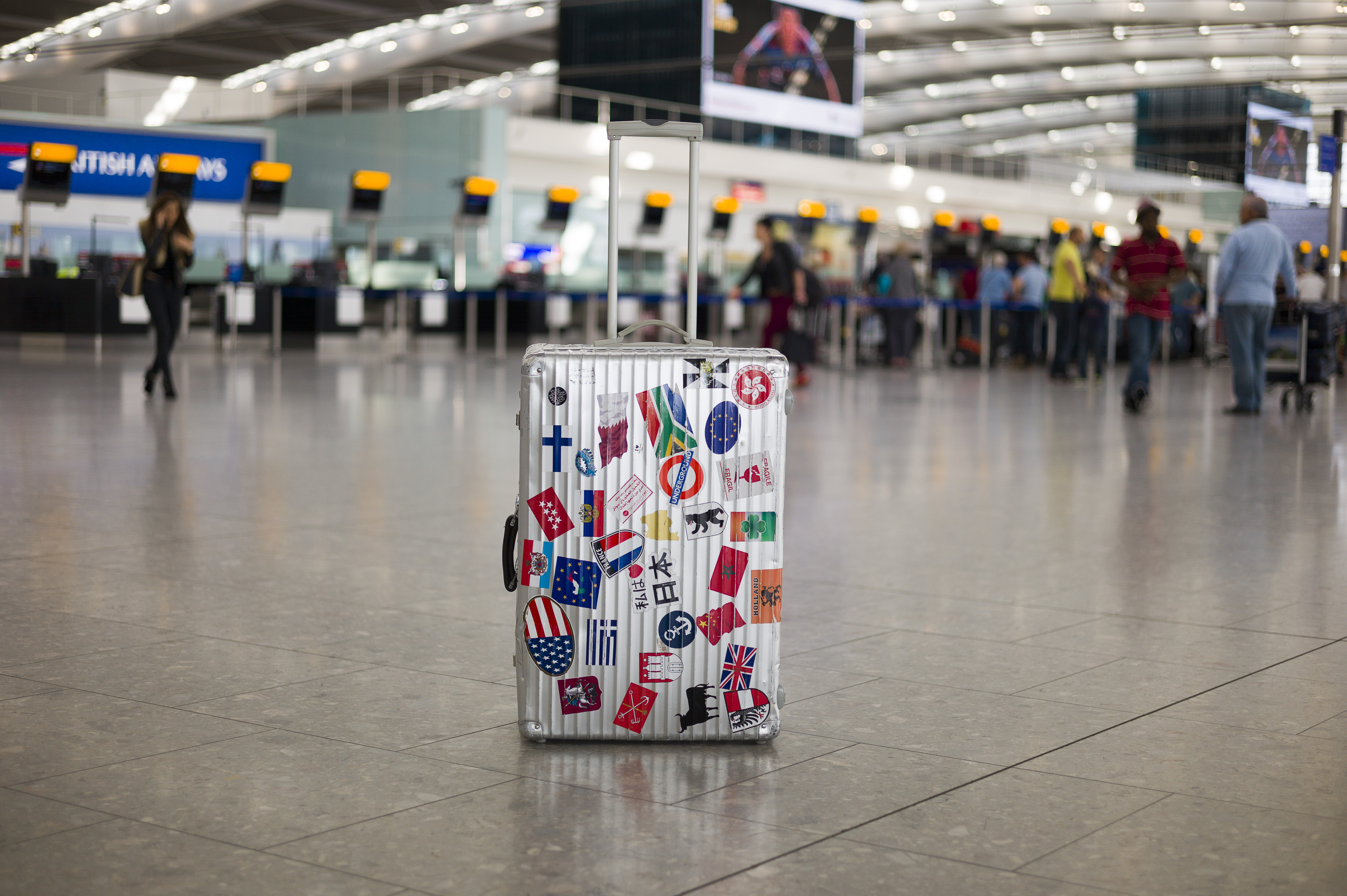 Suitcase with worldwide stickers