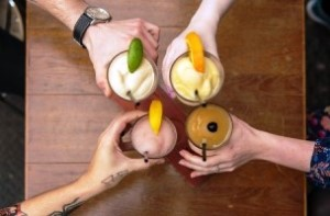 hands with cocktails