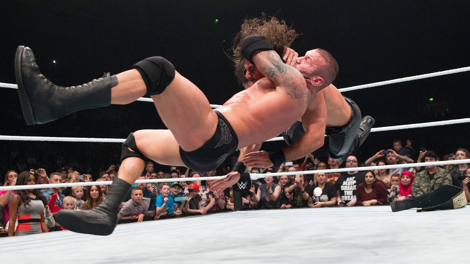 Man doing RKO wrestling move