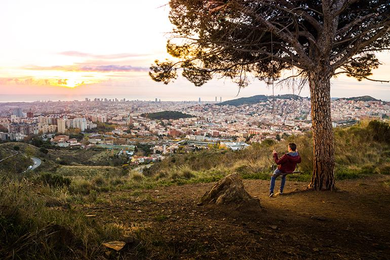 Boy overlooking Spanish city