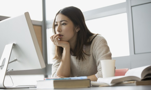 Woman researching best exchange rates