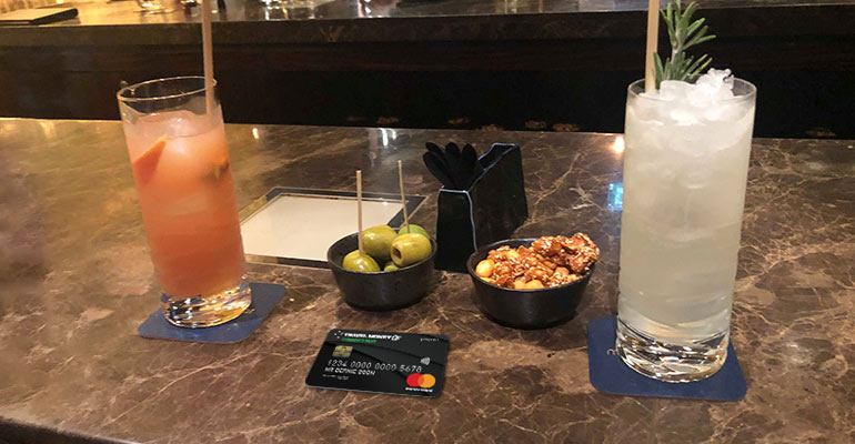 Cocktails and currency pass
