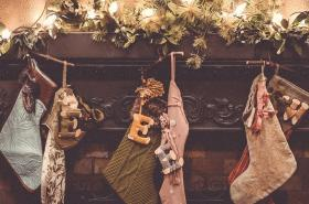 Christmas stockings and decorations hanging from mantle