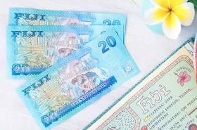 Fijian dollars on table