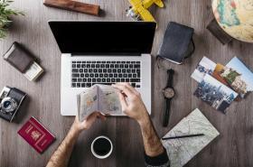Travel preparation on laptop