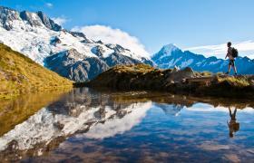 Man walking through NZ mountains