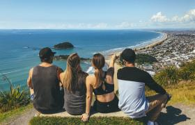 Friends overlooking ocean