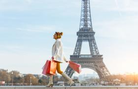 Girl shopping in front of Eiffel tower