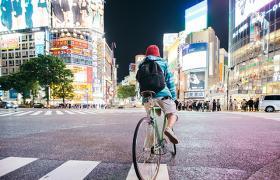 Boy on bike in Tokyo