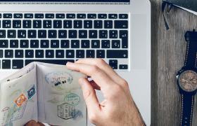 laptop with passport and photos