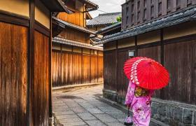 lady walking through street japan
